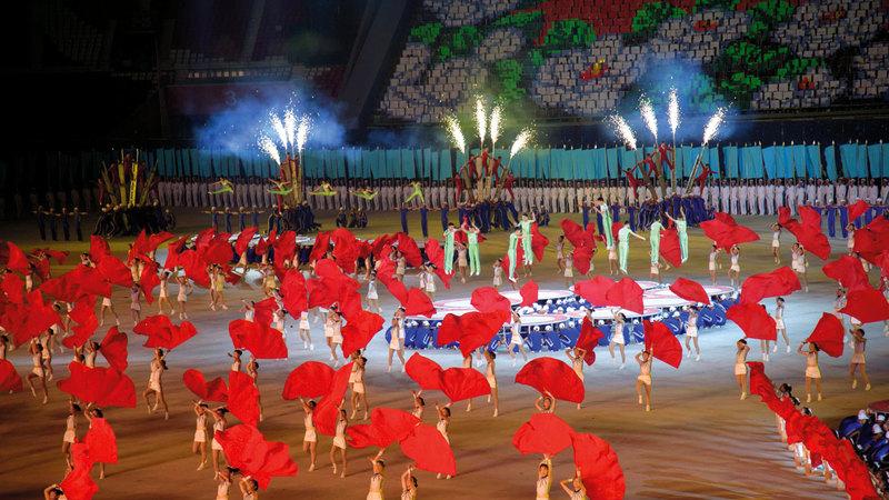 جانب من عروض «أرض الشعب» أحدث برنامج للألعاب الجماعية في كوريا الشمالية. أ.ف.ب