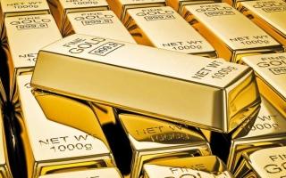 الصورة: الذهب يتجاوز 1400 دولار للمرة الأولى منذ سبتمر 2013