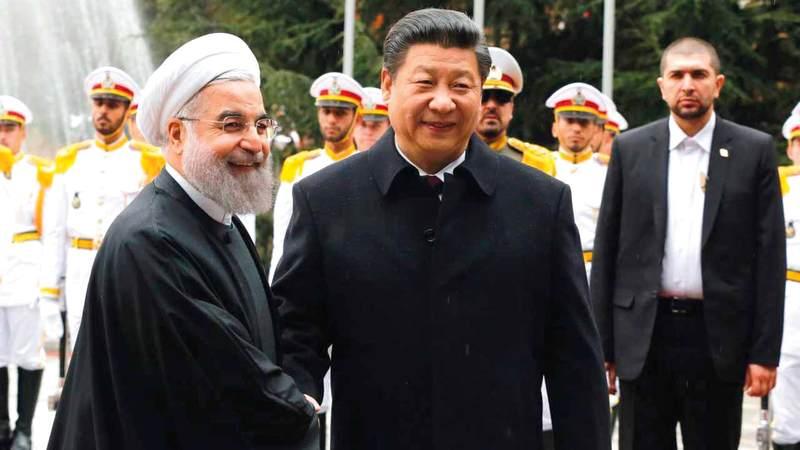 الرئيسان الإيراني والصيني يناقشان سبل مواجهة عقوبات واشنطن.  غيتي