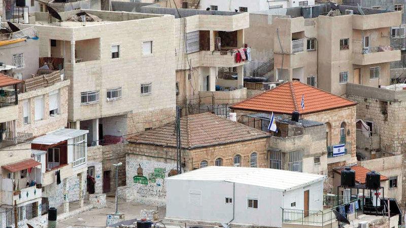 منازل يسيطر عليها مستوطنون شارعها سيحمل اسم حاخام. الإمارات اليوم