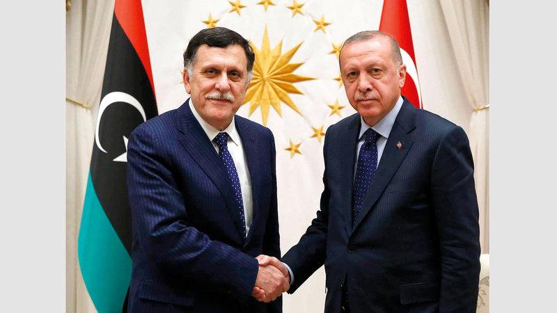 أردوغان والسراج.. تحالف لم يعد خفياً.  أرشيفية