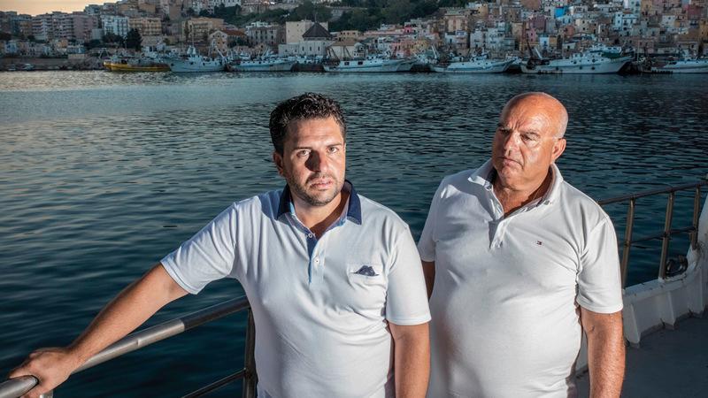 كارلو ووالده.  من المصدر