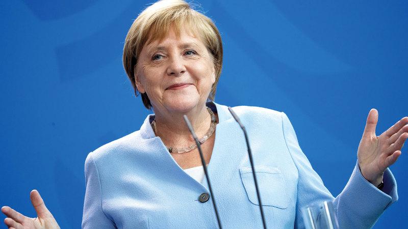 المستشارة الألمانية أنغيلا ميركل وصفت الرئيس بوتين بأنه يعيش في عالم مختلف. إي.بي.إيه