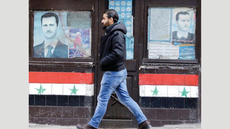 صور الرئيس السوري منتشرة في كل مكان من سورية. أ.ف.ب