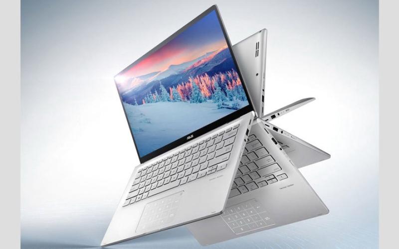 الصورة: «آسوس» تطلق «كمبيوتر» محمولاً جديداً