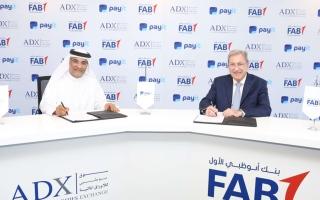 الصورة: «أبوظبي للأوراق المالية» و«أبوظبي الأول» يتيحان توزيع الأرباح إلكترونياً