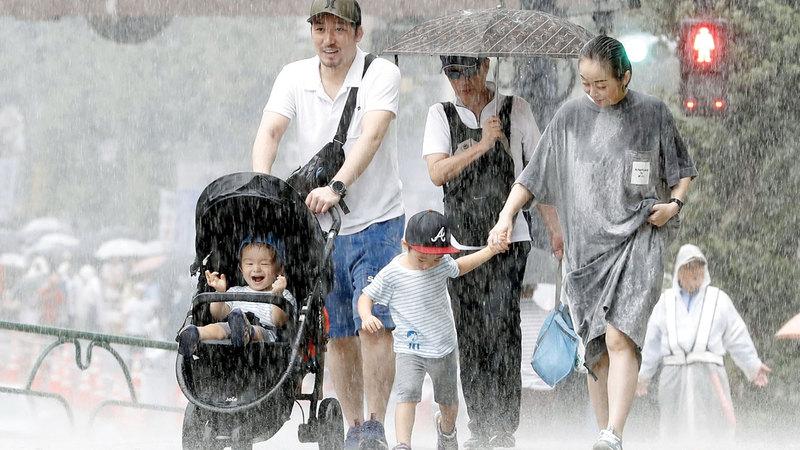 أمطار غزيرة ناجمة عن إعصار فاكساي في طوكيو.  أ.ب