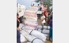 الصورة: مساعدات إماراتية لعشرات الأسر في الساحل الغربي