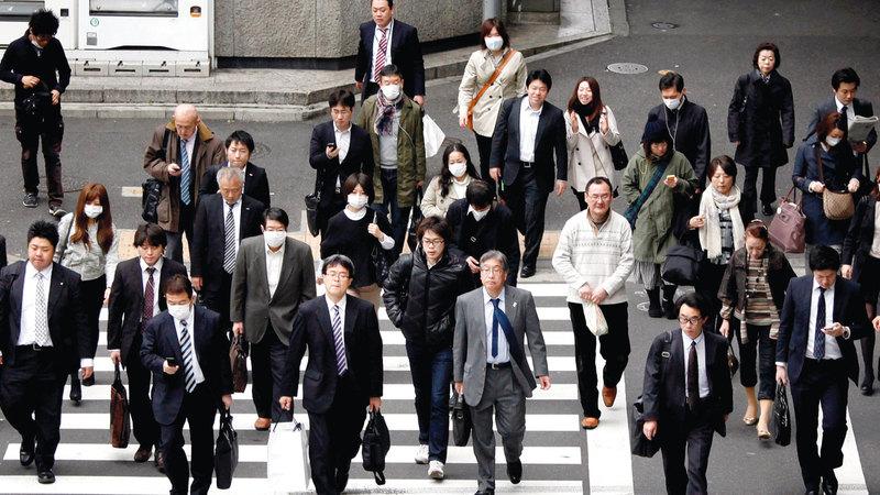 قوانين العمل اليابانية لاتزال صارمة في ظل منافسة كبيرة في الداخل والخارج. أرشيفية
