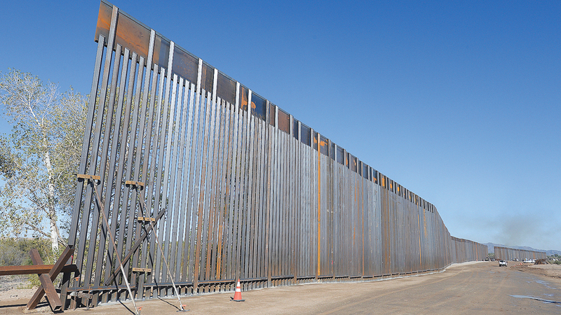 Work continues on the new 30-foot-high, bollard wall along the U.S.-Mexico border on the Colorado River near County 11th Street, Friday, Nov. 1, 2019. When the project is complete, the new wall will stretch for five miles along the border.(Randy Hoeft/The Yuma Sun via AP)