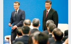 الصورة: شي جينبينغ وماكرون يؤكدان أن «لا عودة عن» اتفاق باريس للمناخ