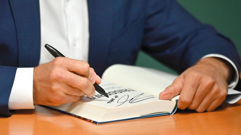 خلال حفل التوقيع على الكتاب. أ.ف.ب
