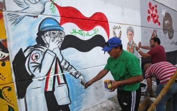 الصورة: بالصور.. الألوان لغة «الثورة» على جدران بغداد