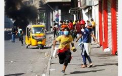 الصورة: قتلى وعشرات المصابين في العراق بعد اتفاق سياسي على إنهاء الاحتجاجات بـ «القوة»