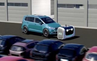 الصورة: روبوت لصف السيارات في مطار فرنسي
