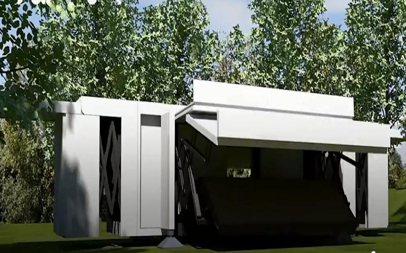 الصورة: بالفيديو.. منازل تطوى في صناديق للنقل والشحن