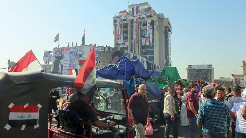 المتظاهرون في ساحة التحرير لم يسلموا من الاعتقالات. أ.ف.ب