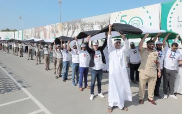 الصورة: عَلَم الإمارات يدخل موسوعة «غينيس» كأطول عَلَم في العالم