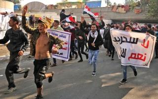 الصورة: مؤيدون لميليشيات «الحشد» ينظمون مسيرة  في ساحة التحرير وسط بغداد