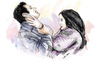الصورة: امرأة تضرب زوجها ويتصالحان في المحكمة