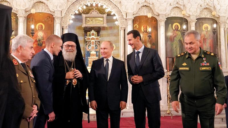 خلال لقاء بوتين مع الرئيس السوري طلب منه دعوة ترامب إلى دمشق. ■أ.ف.ب