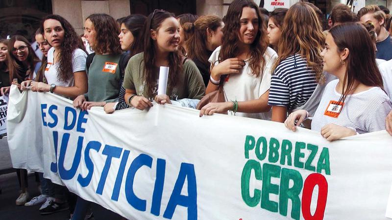 متظاهرات يطالبن بالعدالة الاجتماعية في إسبانيا.  أرشيفية