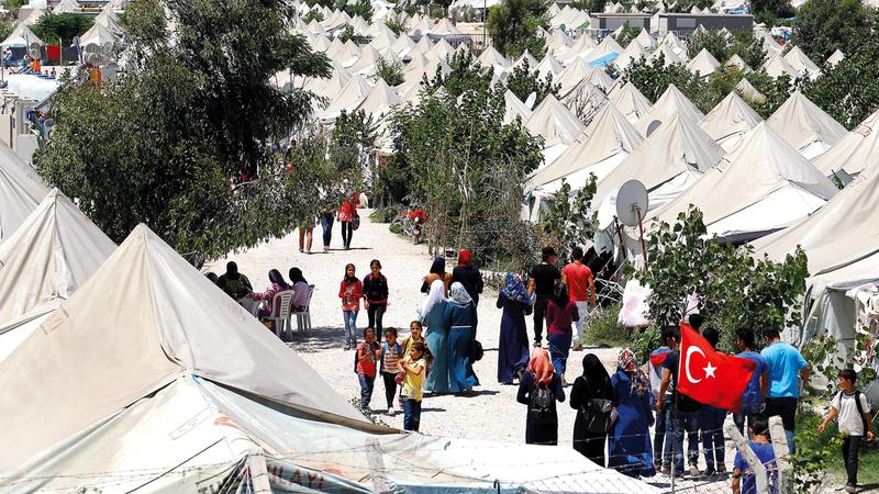 اللاجئون السوريون في تركيا كانوا ورقة رابحة بيد أردوغان. رويترز