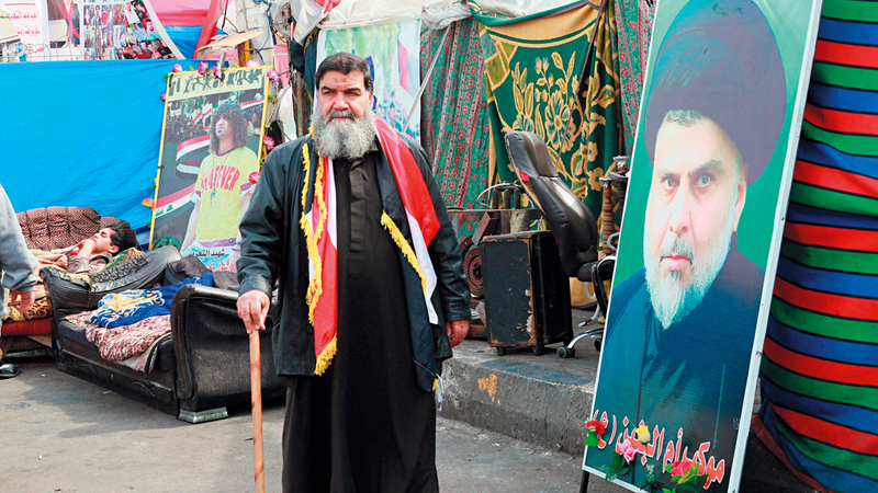 جماعة الصدر كانت حاضرة خلال التظاهرات  لكن لقمع المتظاهرين.   أ.ب