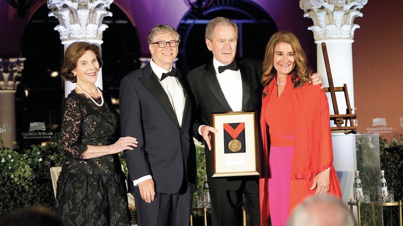جورج بوش كانت له علاقة وثيقة بمؤسس «مايكروسوفت».  أرشيفية