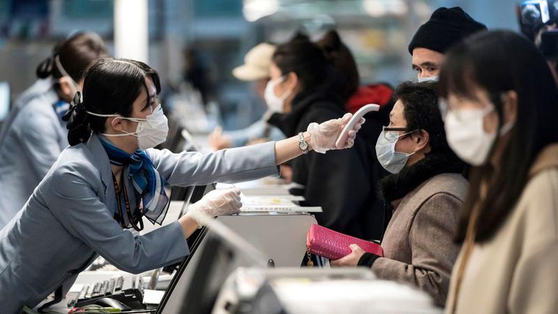 منظمة الصحة العالمية عارضت تعليق السفر الدولي بشدة في البداية.  أرشيفية