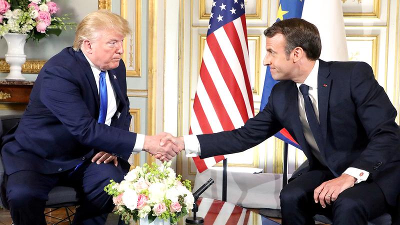 ترامب هدد ماكرون بفرض مزيد من التعاريف الجمركية على المنتجات الفرنسية.  أرشيفية