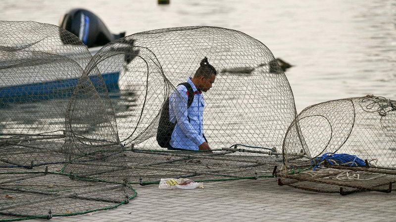 إجادة المهنة الجديدة أتاحت للعمال تحسين أوضاعهم المعيشية. الإمارات اليوم