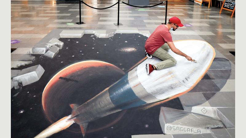 الهاشمي يقدم لوحة ثلاثية الأبعاد تعانق الطموح الإماراتي باستكشاف الفضاء. من المصدر