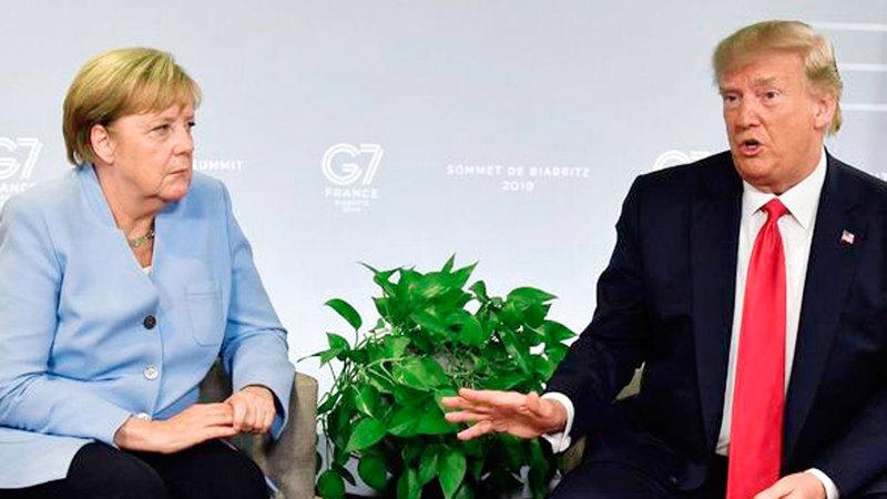 ترامب وميركل في قمة جي 7 العام الماضي. عن المصدر