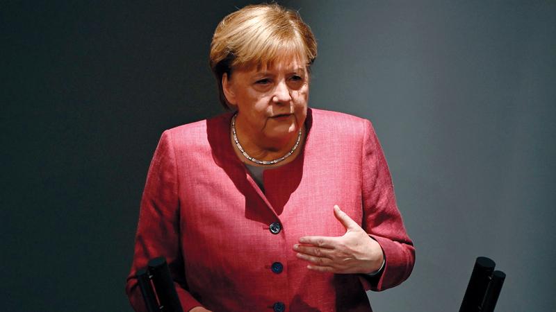 ميركل تعد بمستقبل أفضل لألمانيا الموحدة. أ.ف.ب