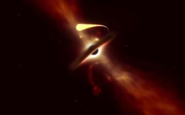 الصورة: فيديو نادر لثقب هائل يلتهم نجماً كاملاً في الفضاء
