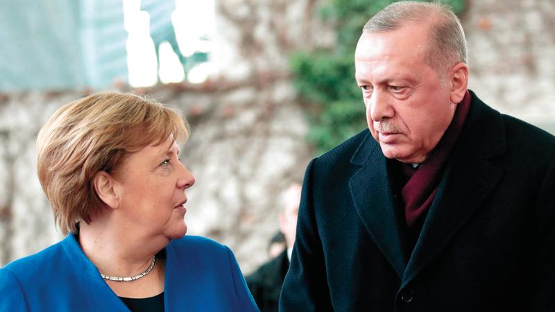 ميركل ظلت نصيرة لاردوغان في عدة محافل دولية. ارشيفية