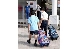 """الصورة: اعتماد فحص """"كورونا"""" لطلبة مدارس أبوظبي من خلال اللعاب"""