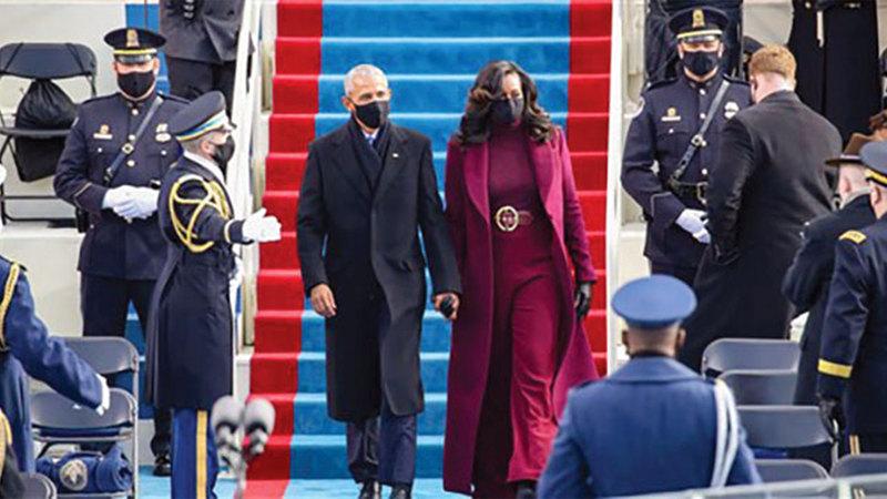 أوباما وزوجته في حفل تنصيب بايدن.  من المصدر