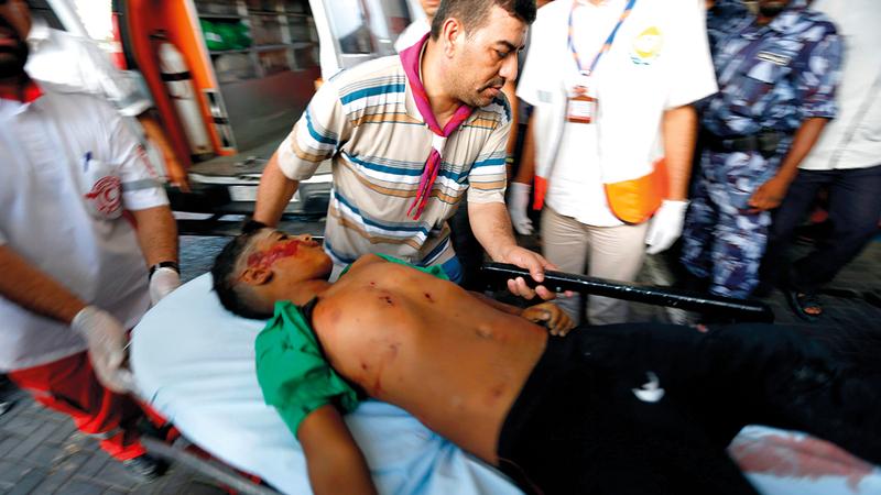 سيد بكر أحد من أصيبوا بجروح في الهجوم على أطفال عائلة بكر على شاطئ غزة عام 2014.    أ.ف.ب