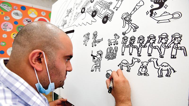 عبدالله لطفي يميل إلى التعبير من خلال الشخصيات الكرتونية التي يقدمها بالأسود والأبيض.  تصوير: باتريك كاستيلو
