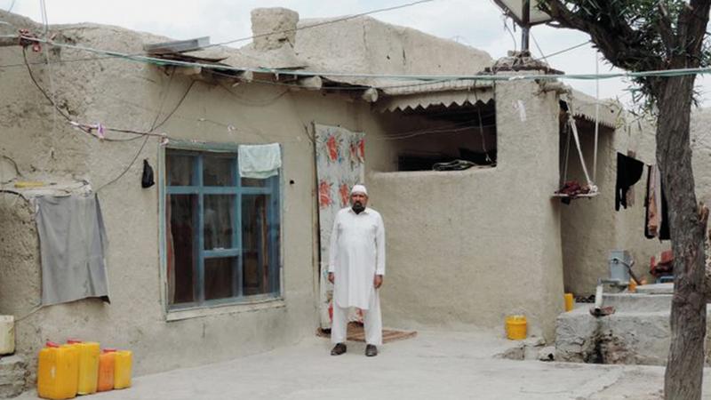 «حبيب الرحمن» في باحة منزله بقريته في خوست.   من المصدر