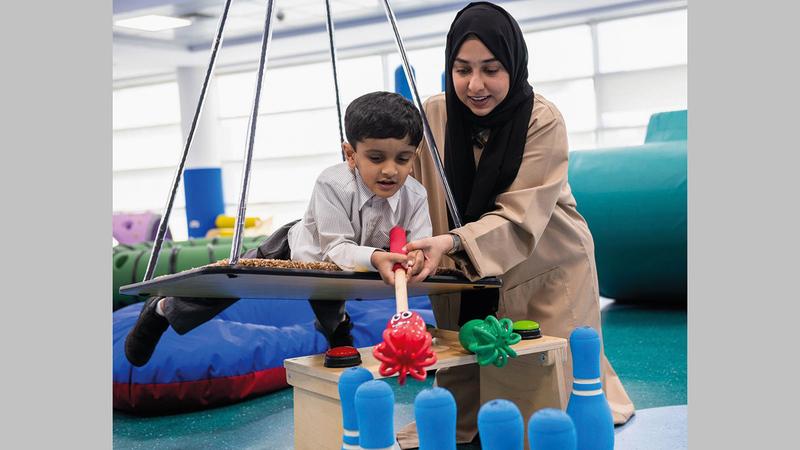 أطفال التوحد قادرون على التعلم بمساعدة أولياء أمورهم ومعلميهم.   أرشيفية