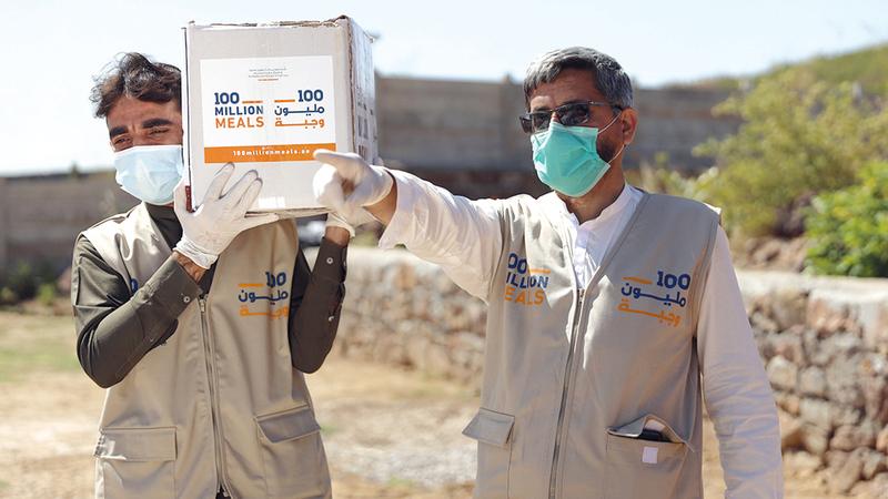«الحملة» تقدم مساعداتها الغذائية بطرود قابلة للتخزين.  أرشيفية