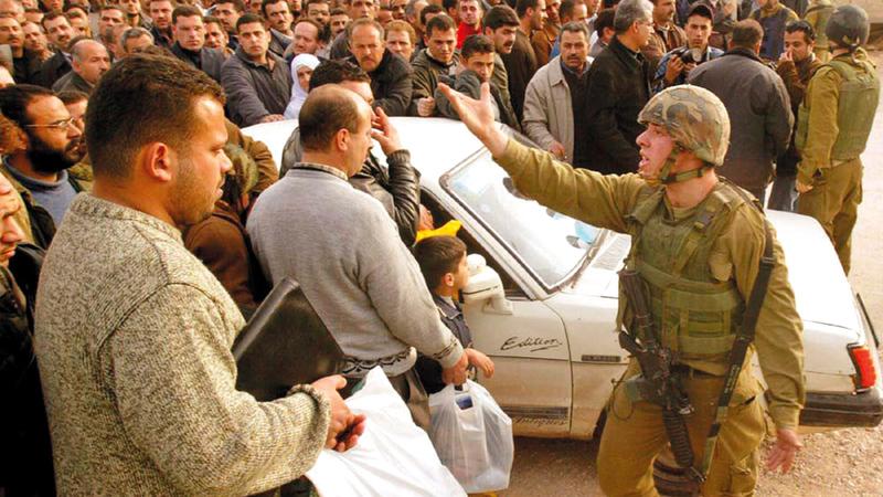 نقاط التفتيش أماكن إذلال للفلسطينيين في الضفة الغربية.   أرشيفية