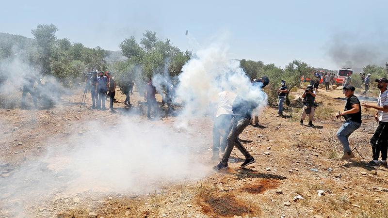 مواجهات مع قوات الاحتلال في قرية بيتا جنوب نابلس. À أ.ف.ب