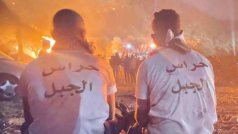 الإرباك الليلي في بلدة «بيتا».  الإمارات اليوم