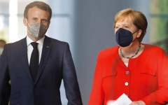 الصورة: ميركل وماكرون لا يريدان بريطانيا أن تفوز ببطولة «يورو 2020»