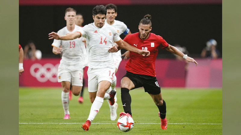 مصر انتزعت تعادلاً مهماً من إسبانيا في اللقاء الافتتاحي.   أ.ب