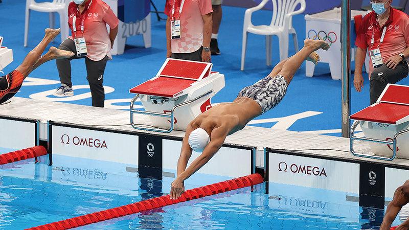يوسف المطروشي خلال المشاركة في الجولة الأولى لسباق 100 متر سباحة حرة.   من المصدر
